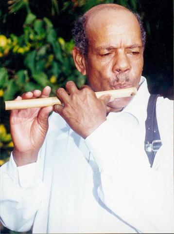 Man playing bamboo flute